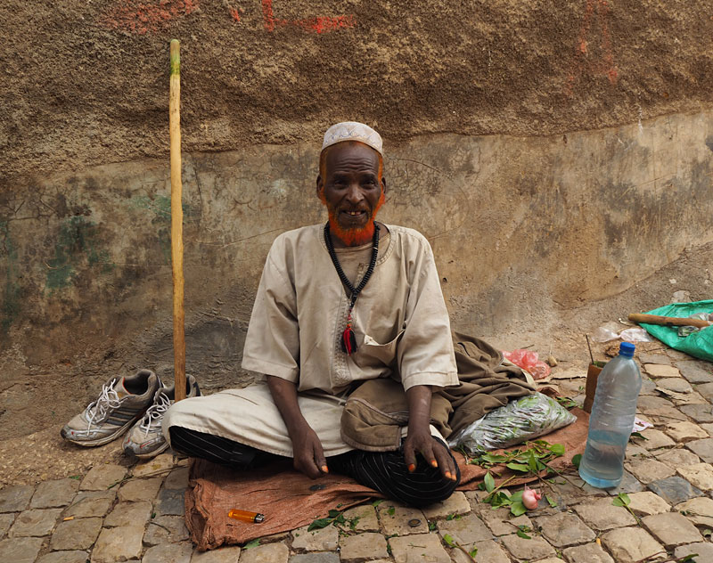 An elderly gentleman in Harar prepares to spend the afternoon chewing chat, a mildly narcotic leaf.