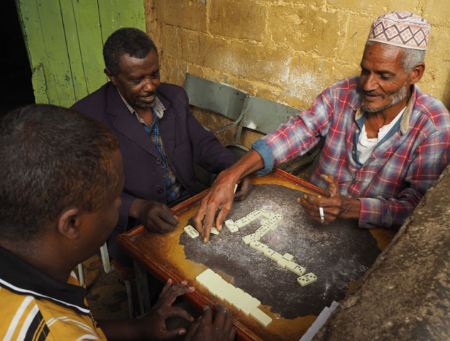 Men play dominoes at a café in Harar.
