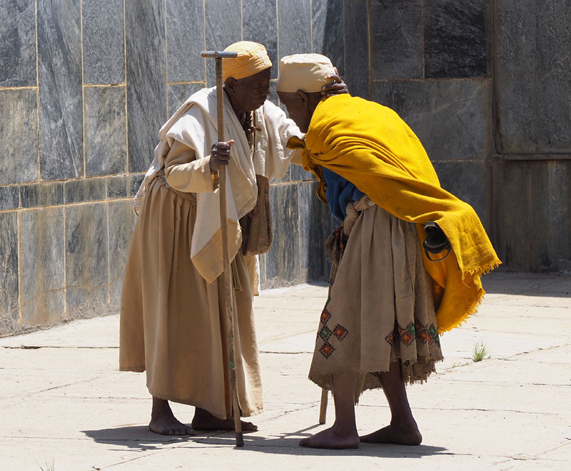 Pilgrims greet each other outside the new Cathedral of St Mary of Zion in Axum.