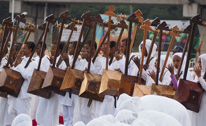 The square fills with musicians playing drums, traditional fiddles and the Ethiopian harp or begena.