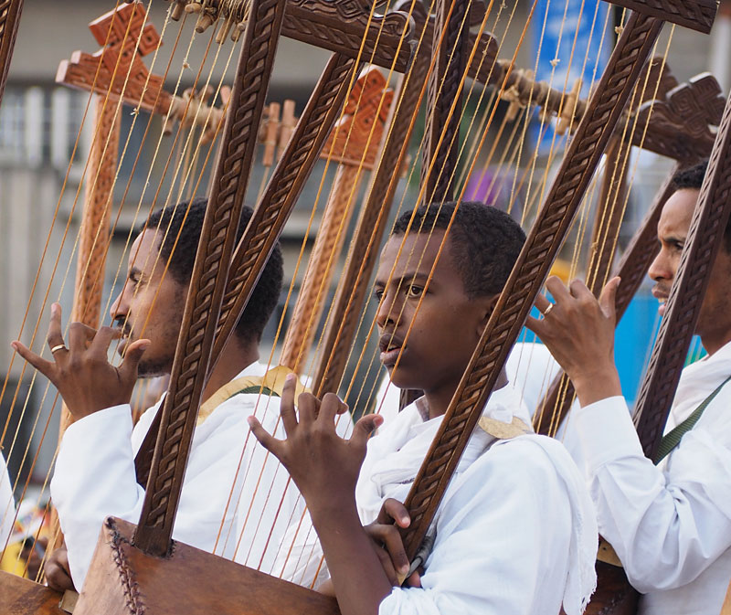 A boy concentrates as he plays the begena, a traditional harp.