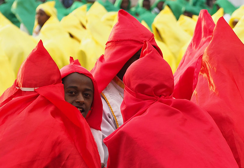 Brightly-robed performers await their turn on Meskel Square.