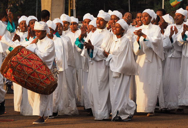 White-robed women dance, clap and sing around Meskel Square.