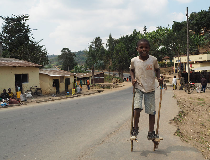 A boy on home-made stilts in a village near Gisenyi.