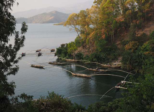 Traditional boats lashed together in threes on Lake Kivu, near Kibuye, await the night's fishing.