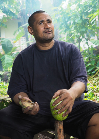 Preparing breadfruit for the umu, a traditional cooking method.