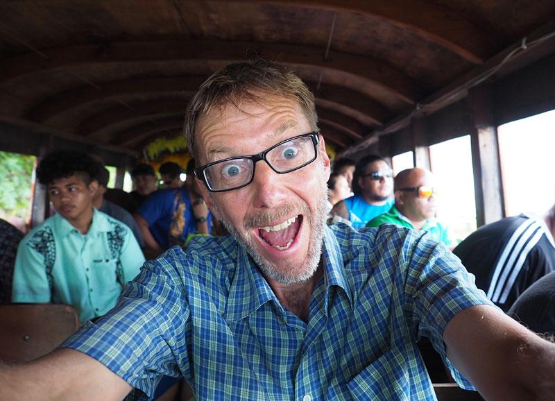The author rides an 'aiga (family) bus.