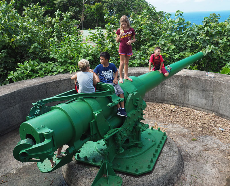 Children play on a World War II cannon at Blunt's Point.