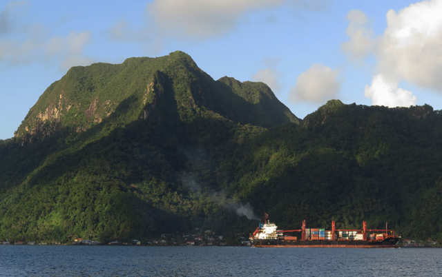 A container ship passes Mt Pioa, also known as Rainmaker Mountain, in Pago Pago Harbour.