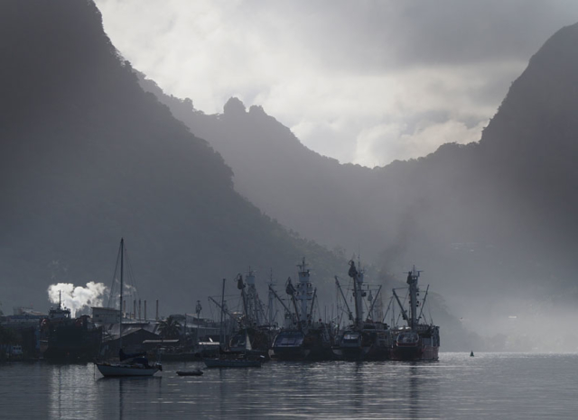 Tuna boats moored alongside the cannery in Pago Pago Harbour.