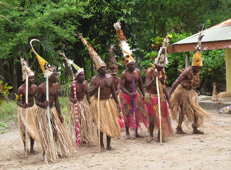 Villagers on Uluveo, in the Maskelyne Islands, prepare for a traditional dance