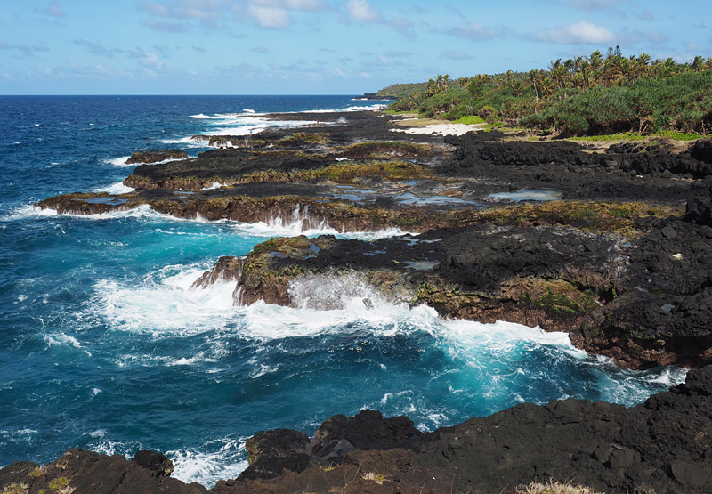 The Vaitogi Lava Fields Walk follows a rugged stretch of coast close to Pago Pago Airport