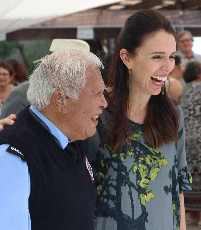 Māori Warden Henare Hape, 84, shares a joke with new Prime Minister Jacinda Ardern at Waitangi