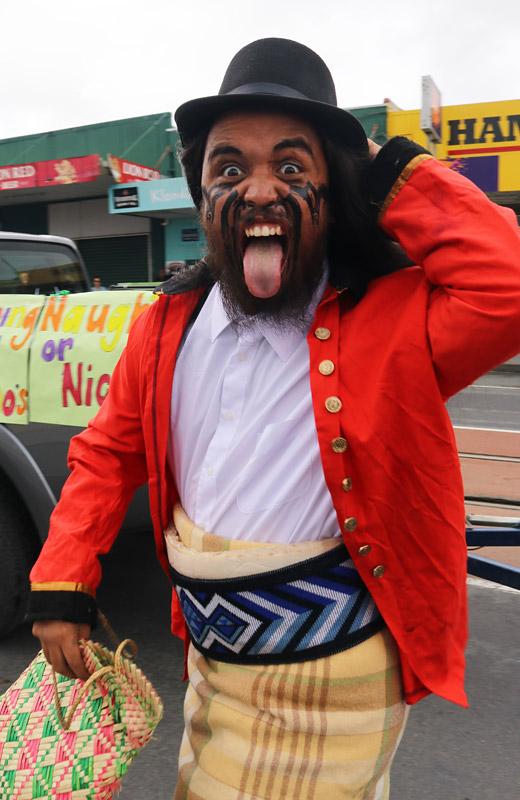 Maru Henare of Ngāti Hine FM pulls a pukana during Kawakawa's Christmas parade