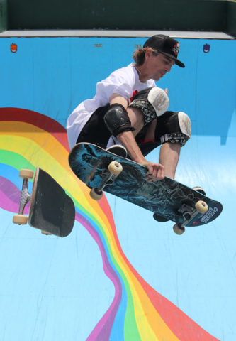 Hamish Stewart switches skateboards in mid-air during a competition in Kerikeri