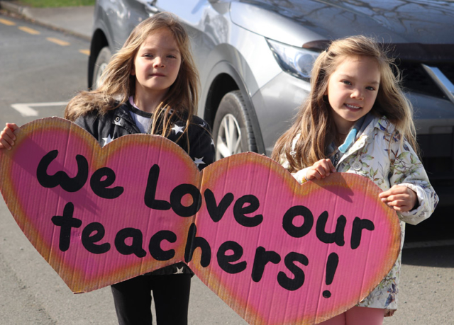 Twins Aimee and Elise show support for their teachers during a protest march through Kerikeri