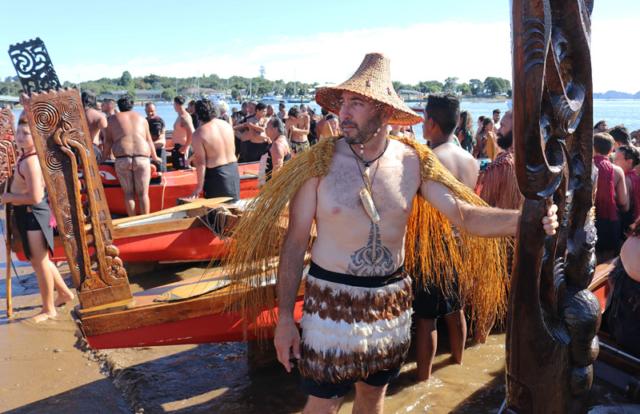 Jef Murupaenga-Ikenn with the waka Kahakura during Waitangi Day festivities