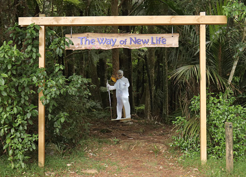 A cut-out of Ilchi Lee welcomes visitors to 'The Way of New Life'