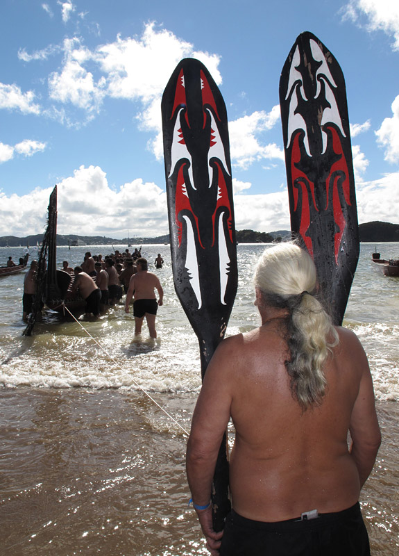 Steerer Paora Mano waits to board the great waka (canoe) Ngātokimatawhaorua