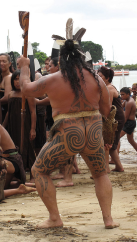 The splendidly tattooed Hone Mihaka leads a haka on Tii Beach