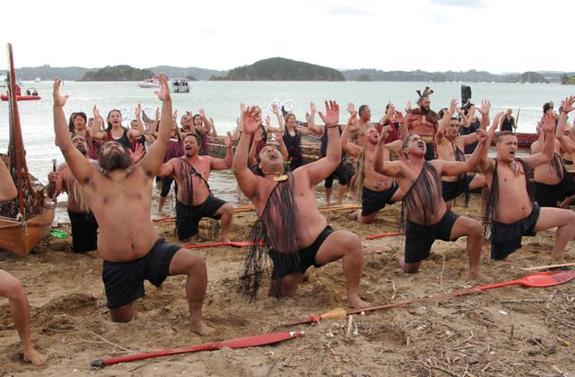 Kaihoe (paddlers) perform a haka on Tii Beach