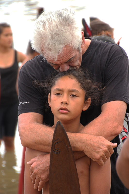 Robert Gabel embraces a mokopuna (grandson) after the waka display