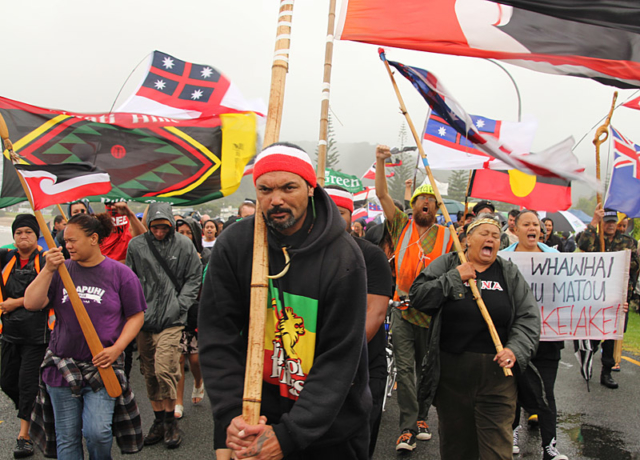 Reti Boynton leads a hīkoi (march) through a summer storm