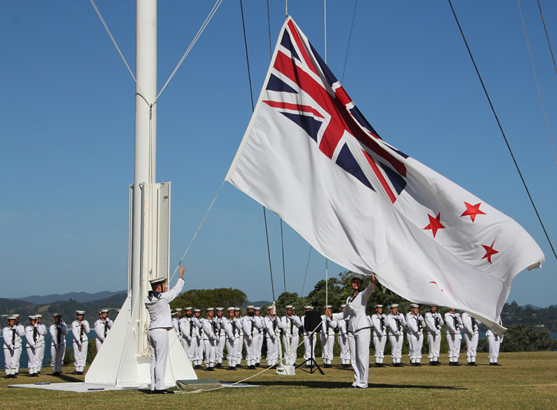The Treaty Grounds flag is lowered as Waitangi Day draws to an end