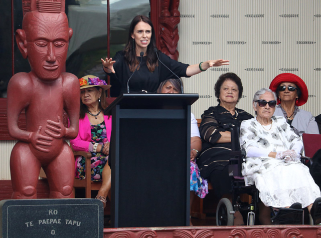 Prime Minister Jacinda Ardern speaks at Te Whare Rūnanga (the carved meeting house)
