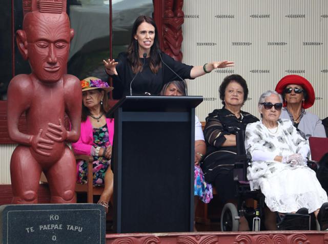 Prime Minister Jacinda Ardern speaks at Te Whare Rūnanga (the carved meeting house)