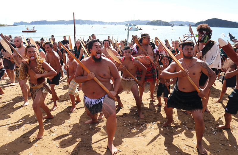 Kaihoe (paddlers) perform a haka on Tii Beach