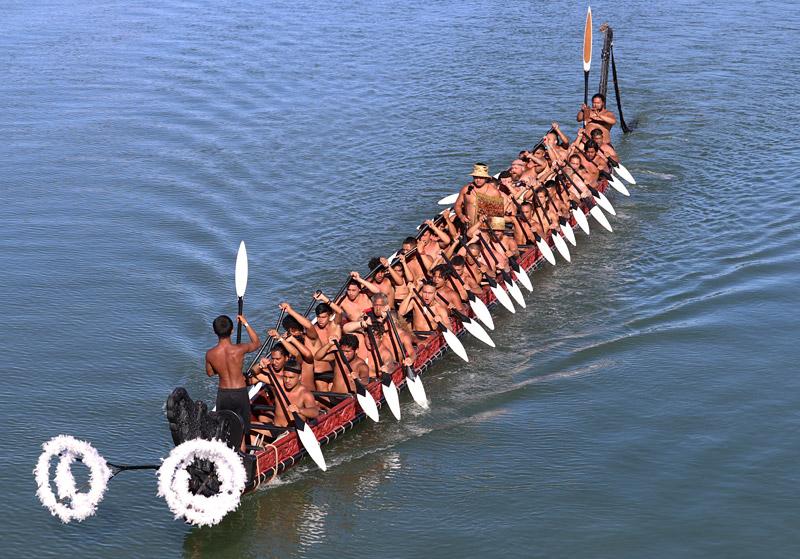 The waka Mataatua slices through the water of Waitangi Estuary