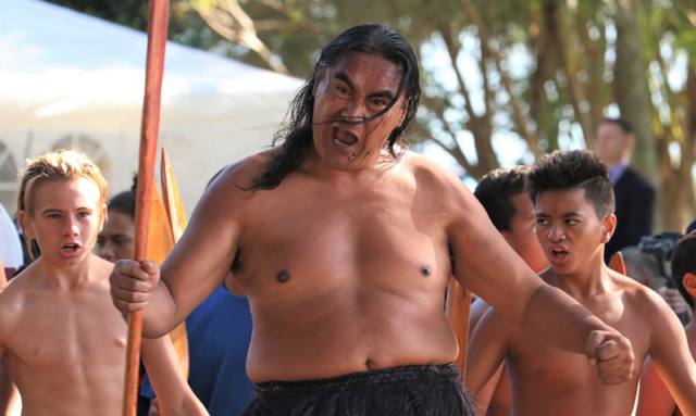 A kaihoe (paddler) performs a haka to welcome Governor-General Dame Patsy Reddy