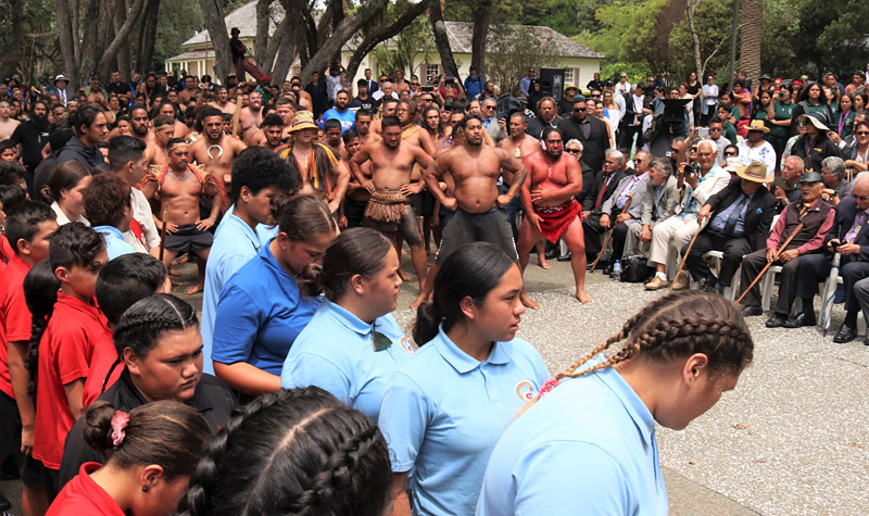 Kaihoe (paddlers) perform a haka for the newly knighted Sir Hekenukumai Puhipi