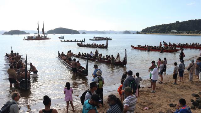 Waka gather at Tii Beach