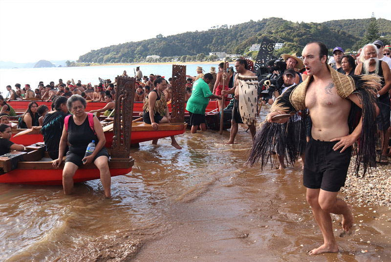 Rutene Gabel recites a chant as the waka land on Tii Beach
