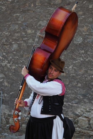 A Moravian double-bass player in traditional dress