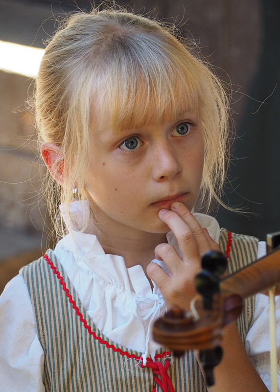 A Czech girl waits pensively for her turn on stage