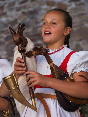 A member of a Czech children's folklore group performs at Strakonice castle