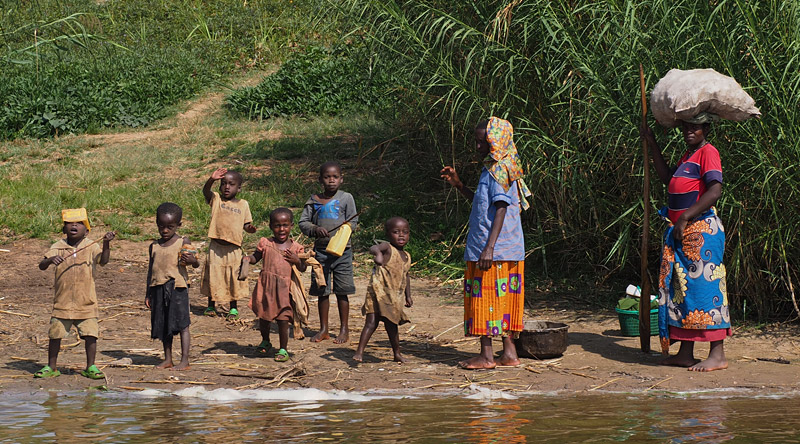 Children wave from the shore of Lake Ruhondo