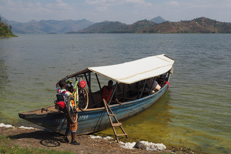 Yannick loads his bicycle onto a ferry across Lake Ruhondo