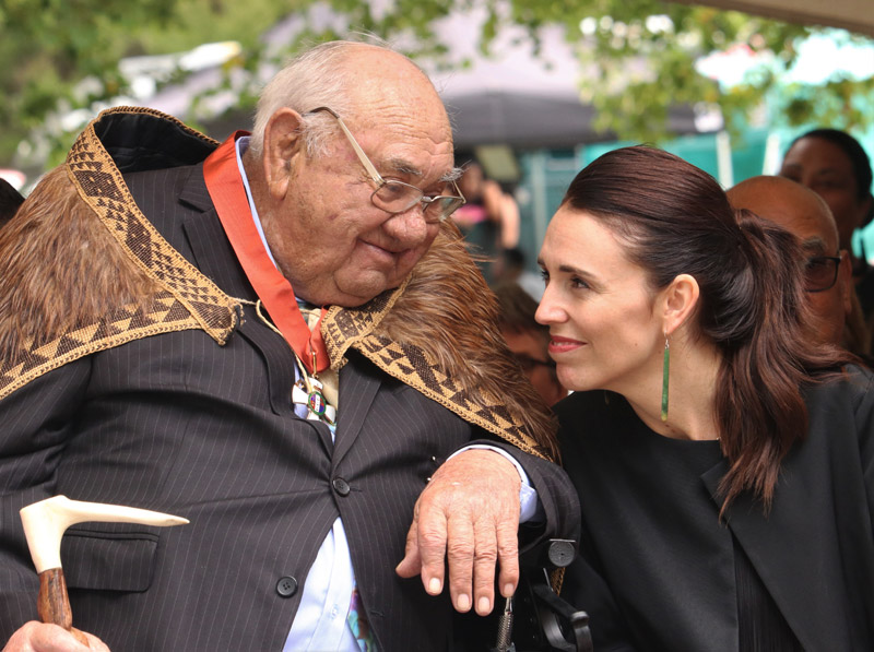 Sir Hekenukumai Puhipi and Prime Minister Jacinda Ardern exchange smiles at Waitangi during the waka-builder's investiture ceremony