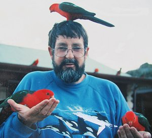 Brian Parkinson with king parrots, ca 1990.