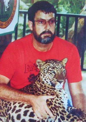 Brian Parkinson cuddles a leopard, ca 1985.