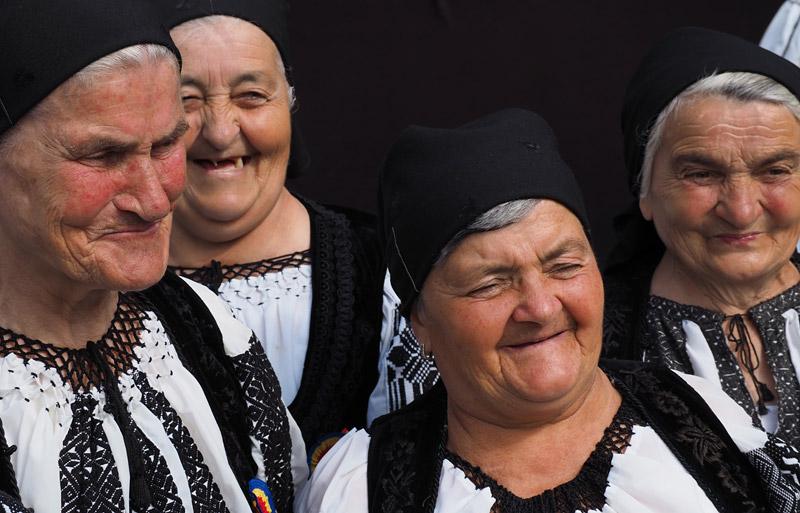 Village women await their turn on stage in Avram Iancu