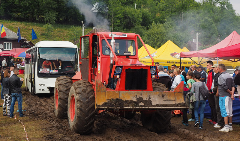A tractor pulls a bus out of the mud in Avram Iancu