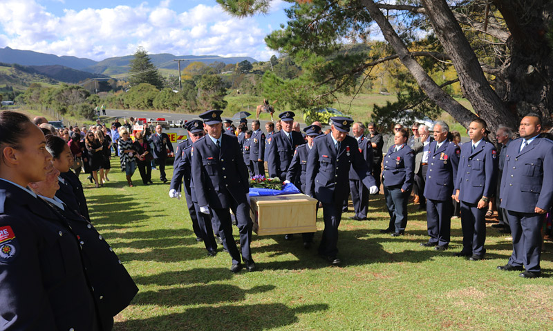 MAY: A guard of honour lines the entrance to Waimamaku cemetery as long-serving Omapere fire chief Dene Preston is laid to rest. Photo: Peter de Graaf