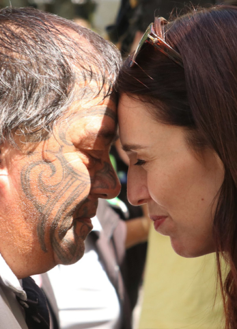 FEBRUARY: Prime Minister Jacinda Ardern shares a hongi with Māori warden Lynn Brown at a wardens' get-together at Haruru Falls. Photo: Peter de Graaf
