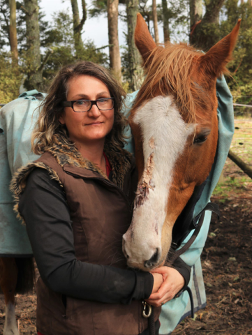 SEPTEMBER: Ingrid Wilkinson with Molly, injured during a massive electrical storm at Waipapa. Photo: Peter de Graaf