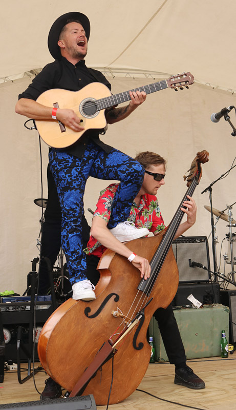 OCTOBER: White Chapel Jak's Nathan Boston picks an unusual spot to play while bassist Michael White carries on undeterred at Paihia's It! Festival. Photo: Peter de Graaf